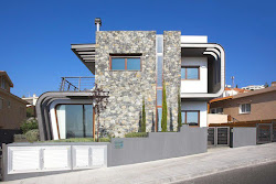 casa dos pisos casas laiki lefkothea piedra planos exterior moderna tsikkinis architecture studio gratis estructura acero modern fachada expuesta hogar