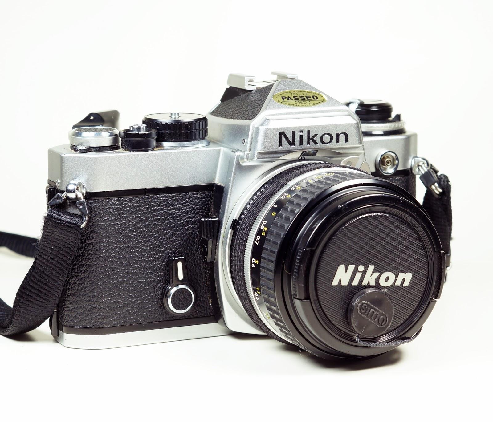 nikon fe 35mm slr film camera nikkor 50mm f 1 4 ai lens graphic trip rh graphictrip blogspot com nikon f2 manual nikon fe2 manual price