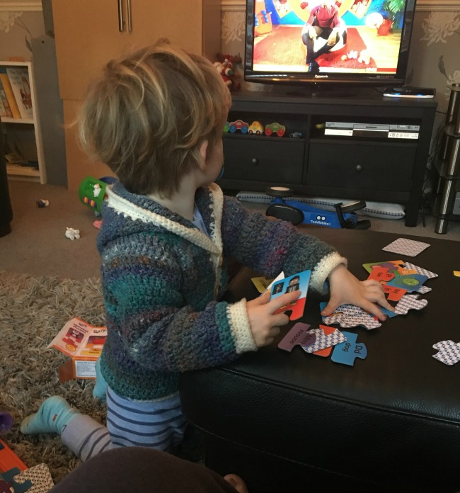 weekly-update-Flu-Bear-and-Me-toddler-watching-tv-and-doing-puzzle