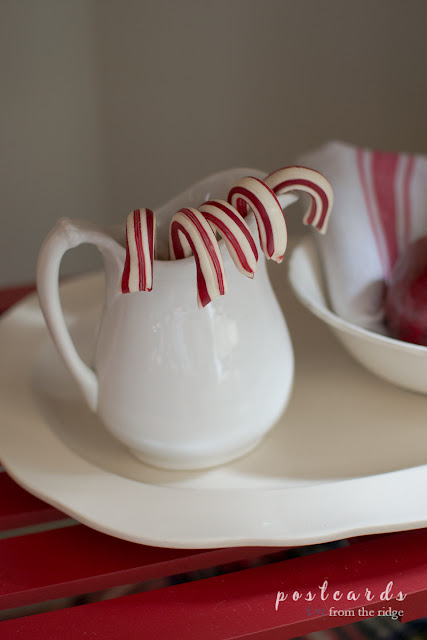 white creamer with peppermint sticks