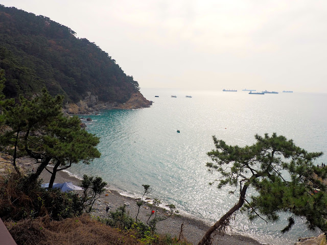 Coastal view overlooking pebble beach in Taejongdae Park, Busan, South Korea