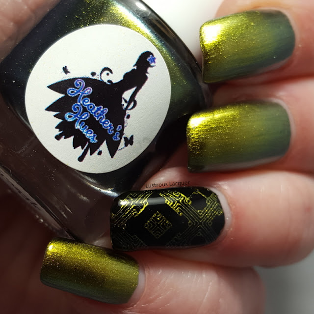 A green to gold shifting multi-chrome polish with flashes of orange