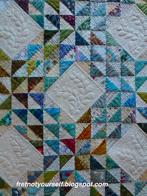 Feather quilting on muslin