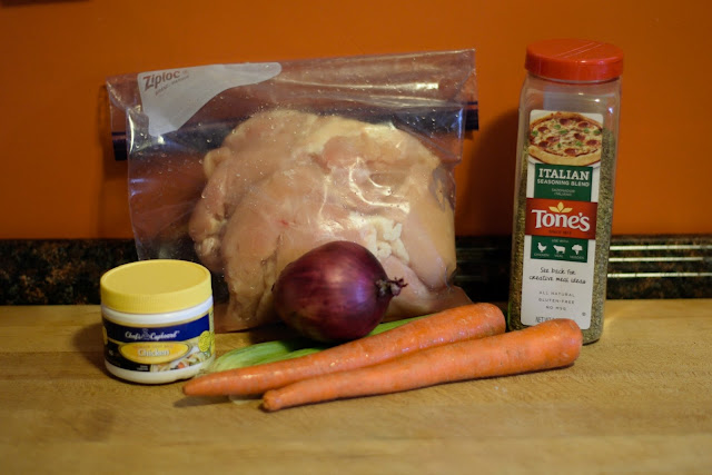 All of the ingredients needed to make the Easy Crock Pot Herbed Chicken Dinner.