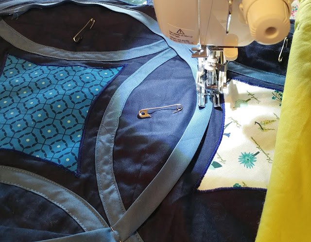 Adding bias tape circles to the Moonrise quilt by Slice of Pi Quilts