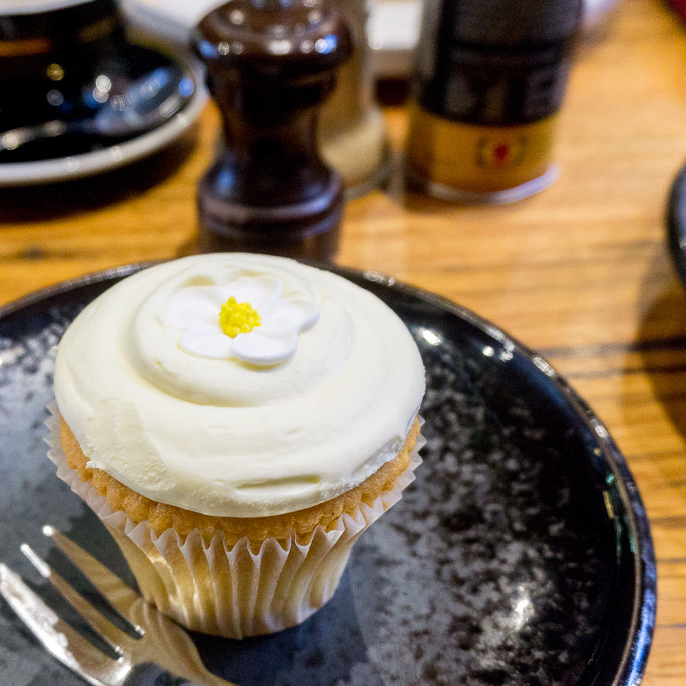 An adorable cream cheese vanilla cupcake that I had for breakfast when catching up with a friend at Journeyman, Windsor | in happenstance