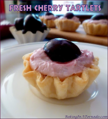 Fresh Cherry Tartlets, fresh juicy cherries and a fluffy cream cheese filling in a quick baked pie crust. | Recipe developed by www.BakingInATornado.com | #recipe #cherry #pie