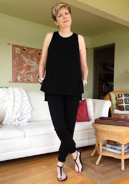 Black Aritzia tank, black Artizia joggers, Michael Kors sandals