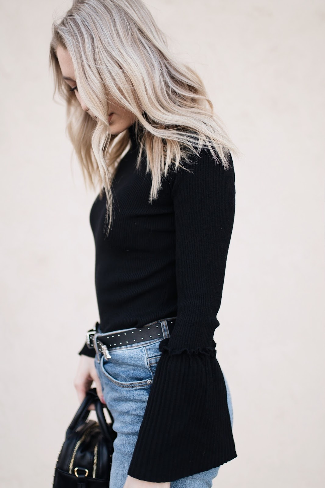 blonde loose waves / black bell sleeve sweater
