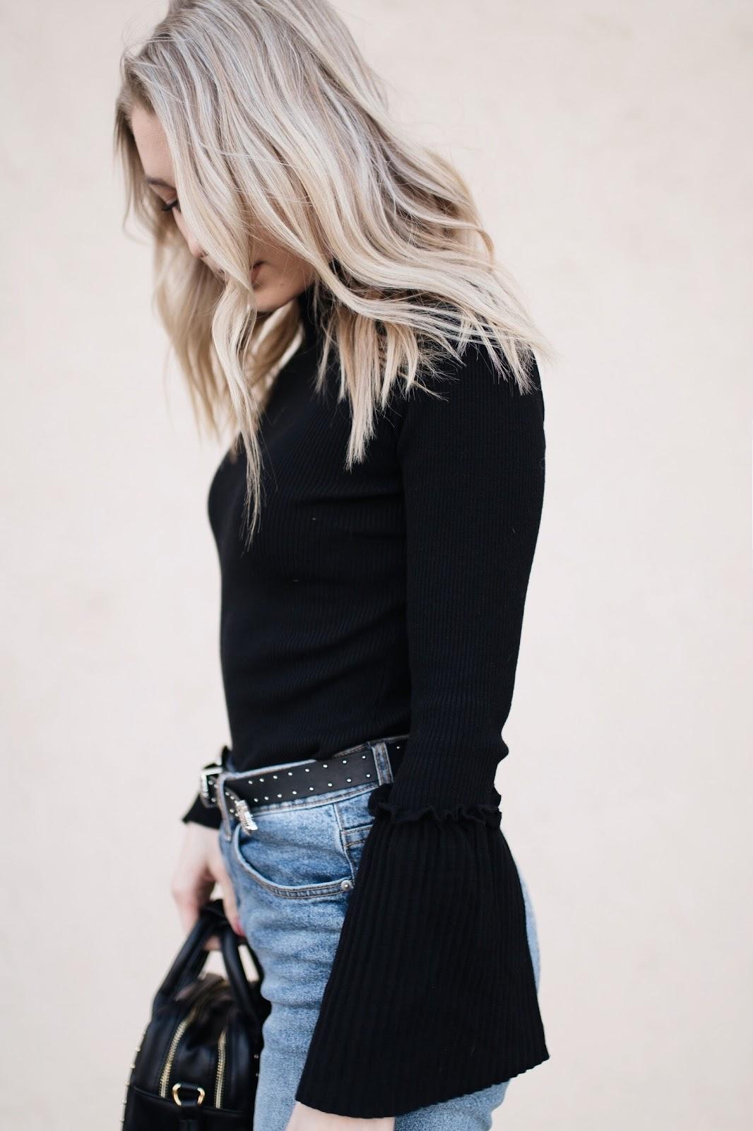 blonde loose waves / black bell sleeve sweater