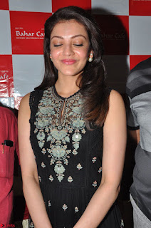 Kajal Aggarwal in lovely Black Sleeveless Anarlaki Dress in Hyderabad at Launch of Bahar Cafe at Madinaguda 027.JPG