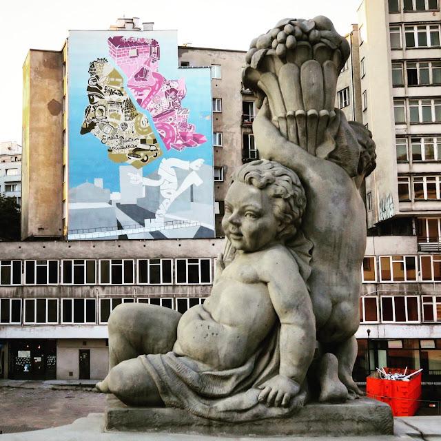 Cherub statue and street art in Warsaw, Poland