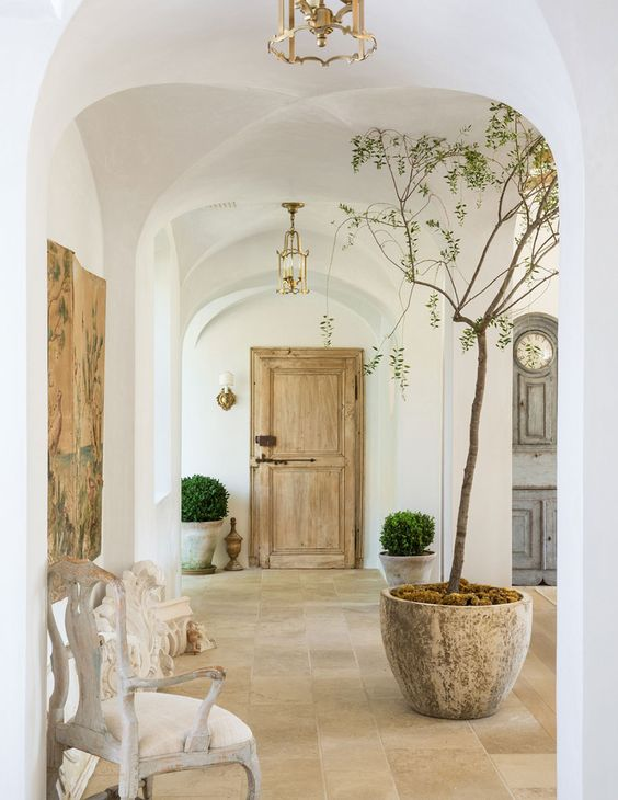 Beautiful European farmhouse (Patina Farm) with vintage door and plaster walls