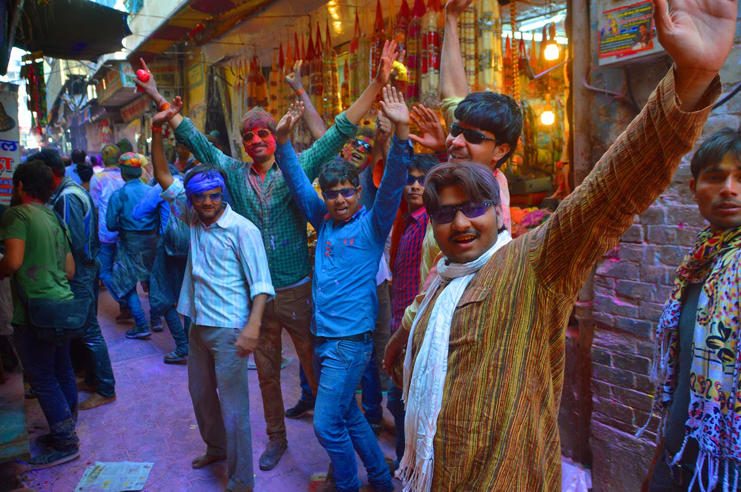 Local Indian men on streets Holi Banke Bihari Temple Vrindavan 2015 colors gulal red yellow green men