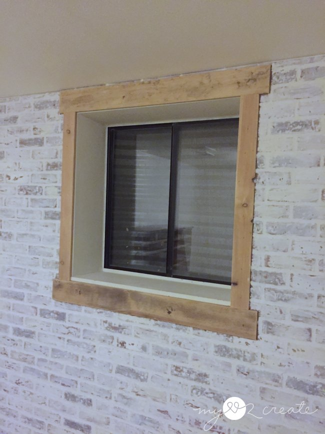 white faux brick wall and window trim
