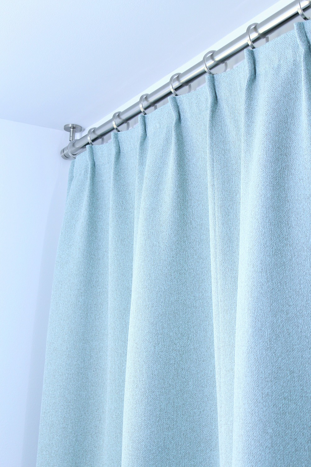 Ceiling Mounted Shower Curtain Rod + Turquoise Shower Curtain in Modern Bathroom Reno | www.danslelakehouse.com