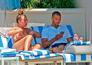 Model Jeremy Meeks and heiress Chloe Green kissing by pool