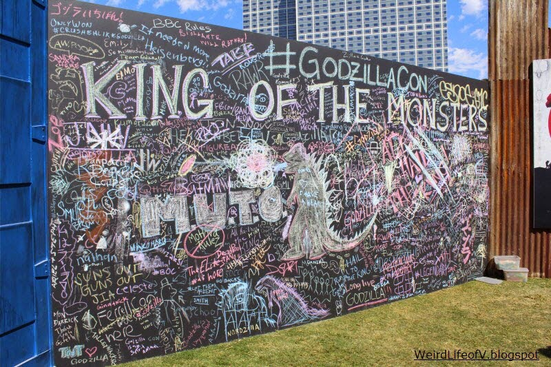 Giant chalkboard for attendees to write and/draw on in the Godzilla installation