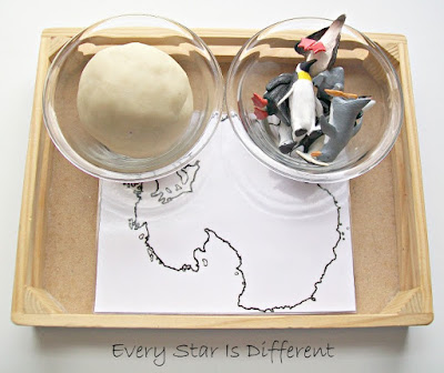 Montessori-inspired play dough and penguins Antarctica activity for kids.