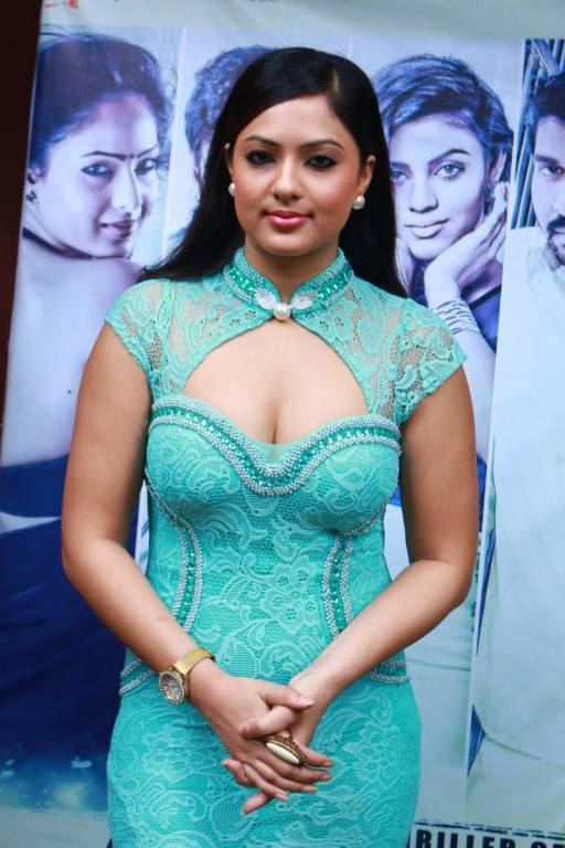 Kollywood Actress Nikesha Patel Sizzling At Audio Launch In Green Dress