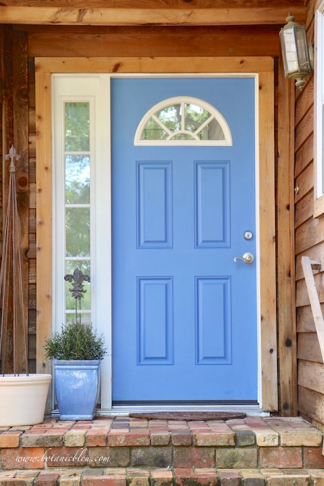 Fall entry garden curb appeal with a blue painted door and antique brick porch
