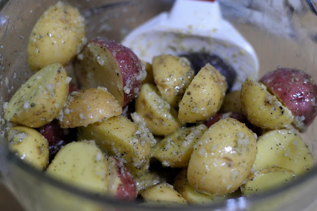 The raw potatoes tossed in all of the seasonings.