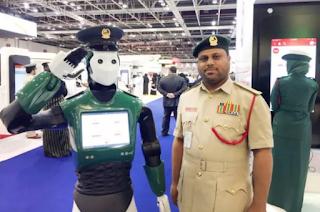 A Dubai Policeman Stands With Robocop