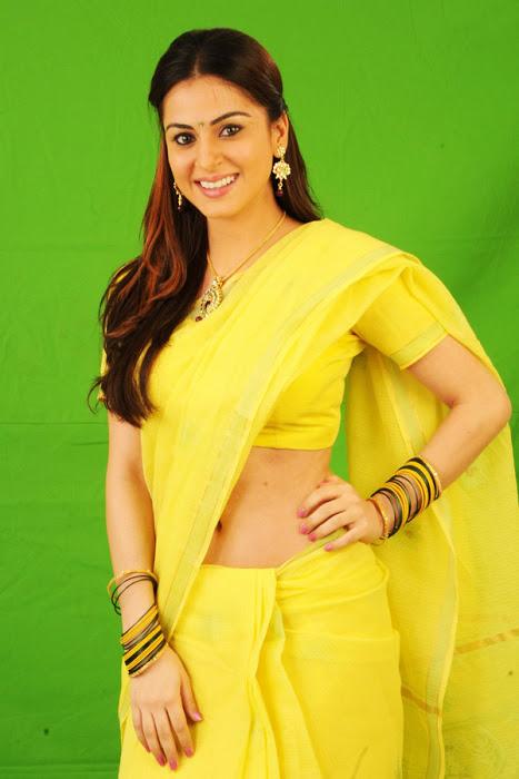 Enticing and charming Shraddha arya hot navel show stills in yellow saree