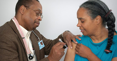 African American woman getting flu shot