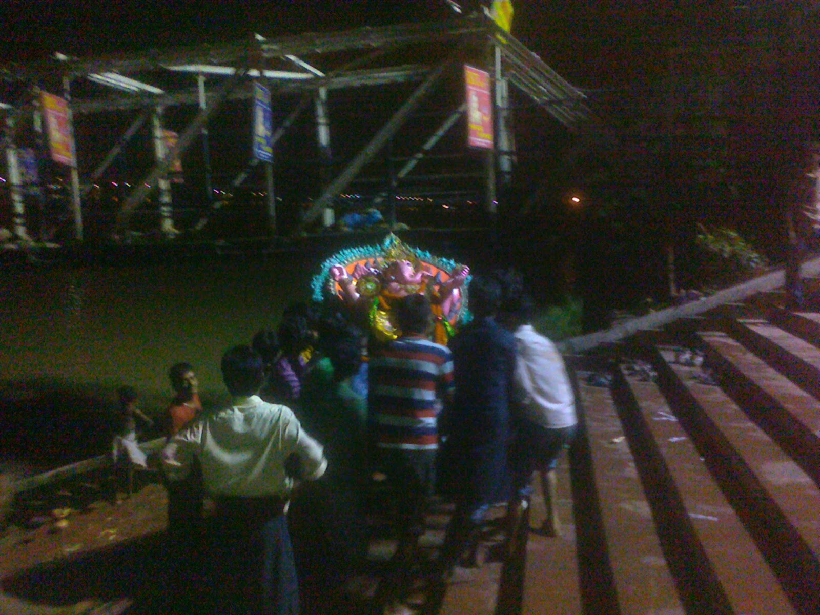Lord Ganesha puja idol immersion visarjan rituals performed at river ganga ghat howrah