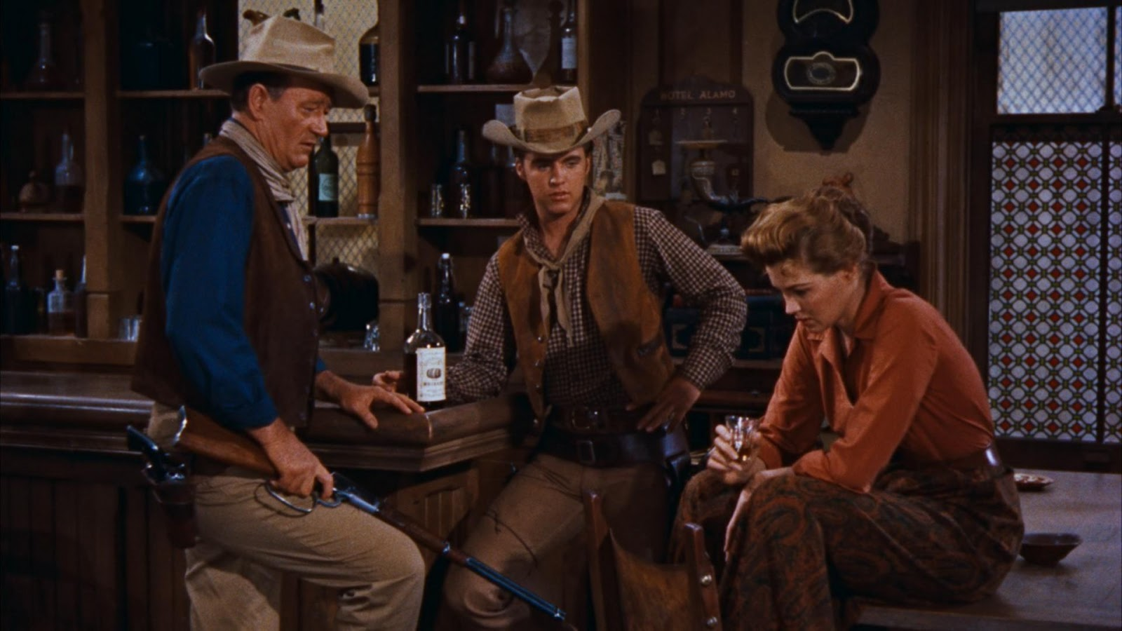 rio bravo Rio bravo blu-ray (1959): starring john wayne, dean martin and ricky nelson a small-town sheriff enlists the help of a cripple, a drunk, and a young gunfighter in his efforts to hold in jail the.