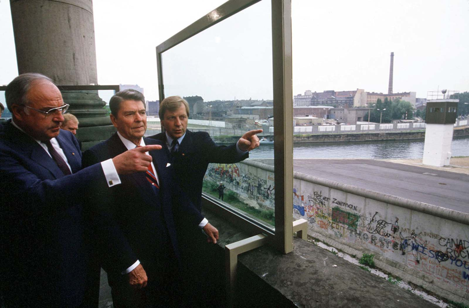U.S. President Ronald Reagan visits the Berlin Wall with German Chancellor Helmut Kohl (left), in June 1987.
