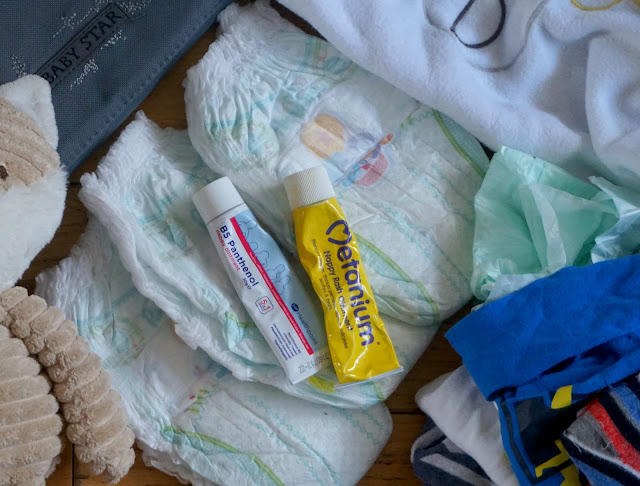 nappies, barrier cream and nappy sacks flat lay