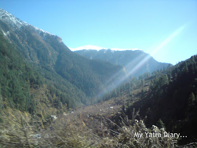 Glowing streak of snow clad mountainous peaks in the Garhwal Himalayas in Uttarakhand