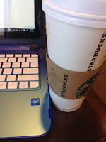 Coffee and computer at Starbucks - blogging and relaxing