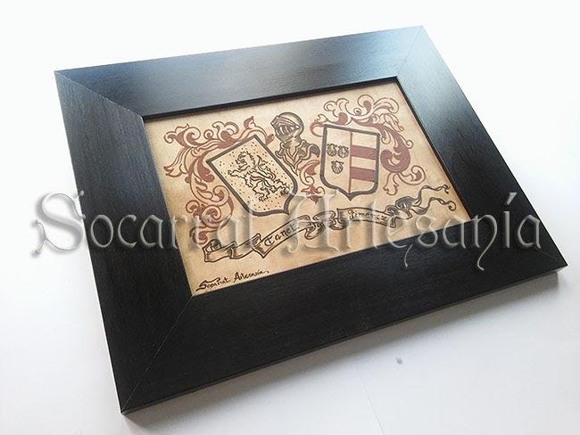 Socarrat  con marco de 7cm y con escudo heráldico. Socarrat Artesanía