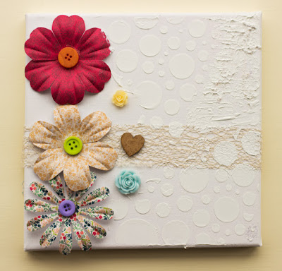 canvas with floral embellishments and tecture paste