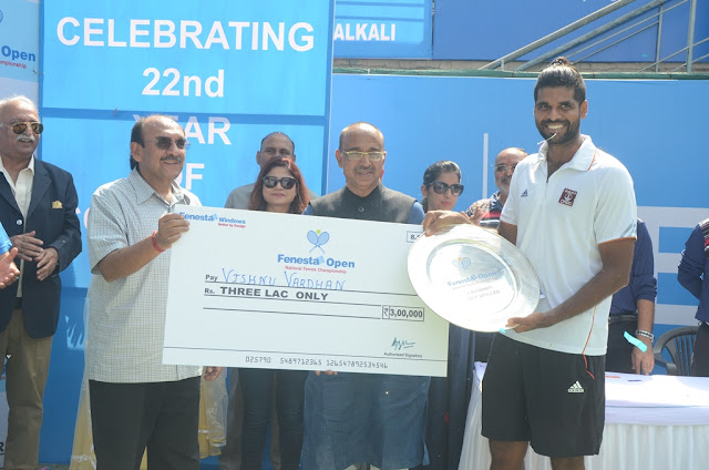 Winner of the Men's  single Vishnu Vardhan with Sports Minister Mr. Vija...