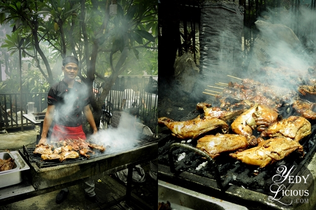 Happy Food Attendant by the Grill at Three Sister's Restaurant of Pasig