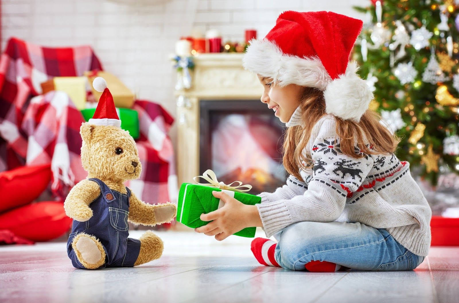 Kids emotions and excited for christmas surprise gifts hd images cute kid presents gift to her teddy christmas negle Gallery