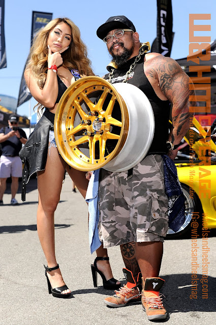top model Marie Madore in deep v top and denim shorts and Big Abe with his big wheel on his neck at Formula Drift 2017