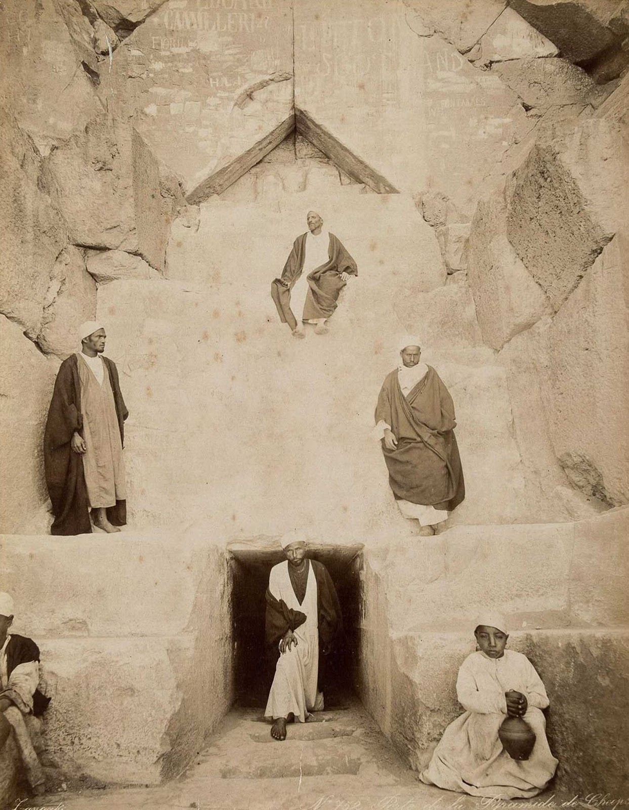 Men at the entrance to the Great Pyramid of Giza.
