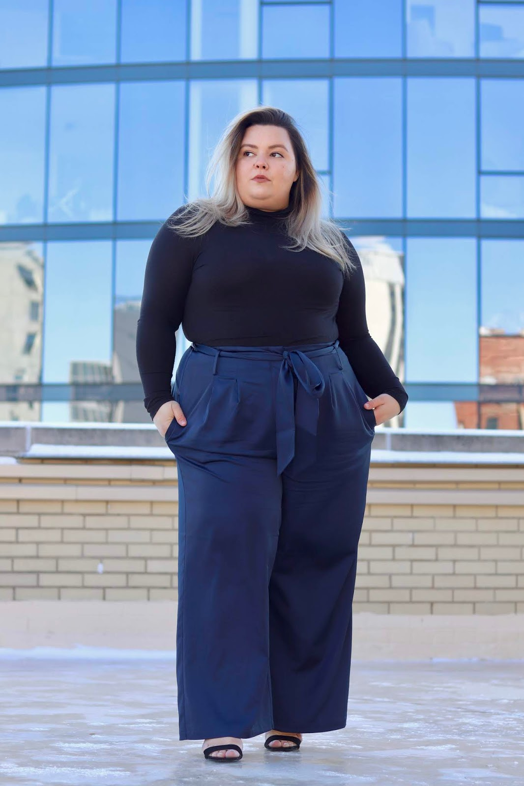Chicago Plus Size Petite Fashion Blogger, influencer, YouTuber, and model Natalie Craig, of Natalie in the City, reviews Universal Standard's plus size petite wide leg satin pants and turtle necks.