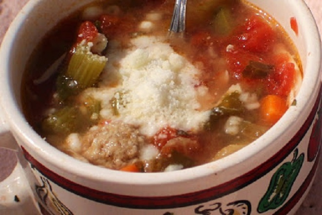 this is a bowl of vegetables soup tomato, carrots, peas and how to make a red vegetable soup
