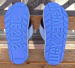 Funny Jesus loves you flip flops clothing photo
