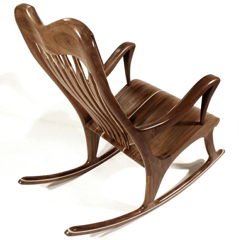 Muebles y decoraci n de interiores sillas mecedoras el for Mecedoras modernas