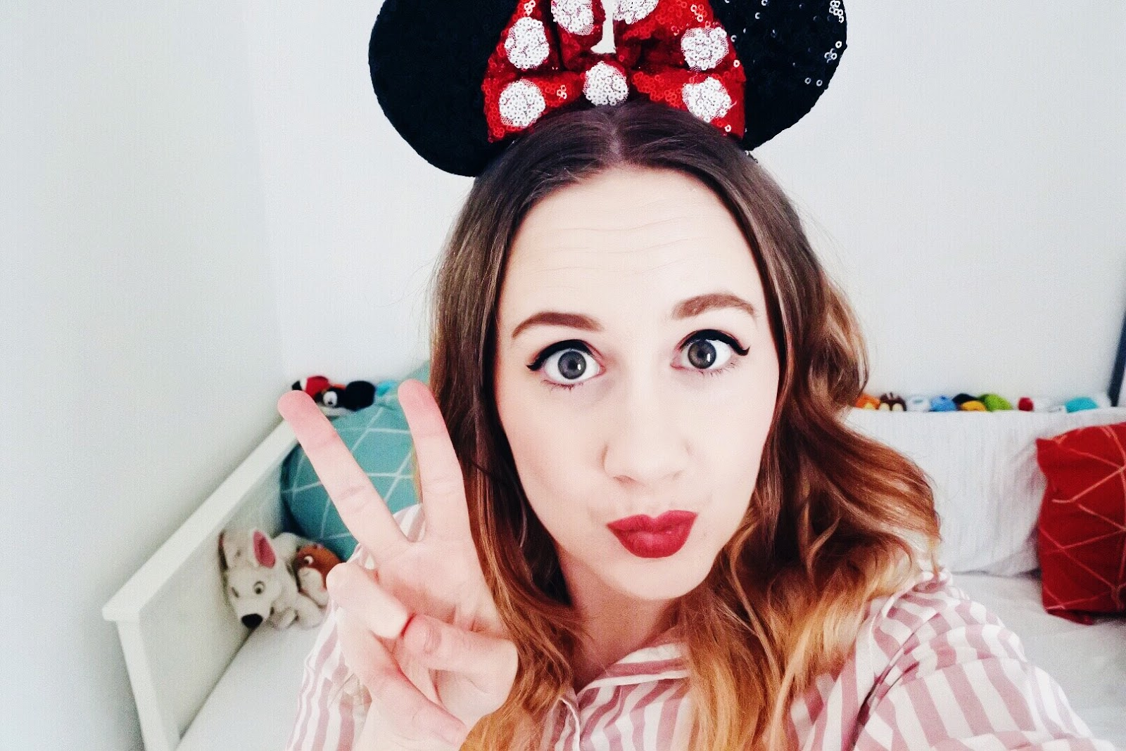 Jemma taking a selfie wearing sequin Minnie Mouse ears.