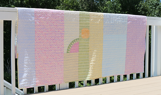Back of Modern Quilt Featuring Two Orphan Blocks and Wide Strips of Fabric