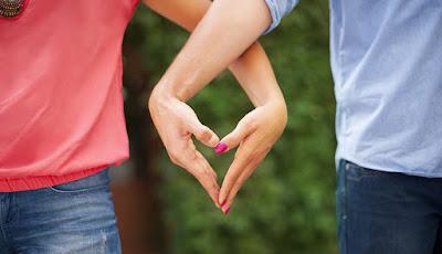 Good Relationship man woman hands shape heart romance love