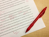 a piece of paper that has been edited in red ink